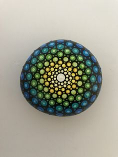 A personal favorite from my Etsy shop https://www.etsy.com/listing/495322702/mandala-stone-hand-painted-rock-dot