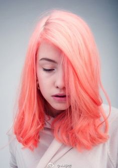 Pastel melon colored dye. Pastels are in nowadays and you can simply dye your hair in this bright and pretty looking pastel melon color to stand out from the crowd and be unique.