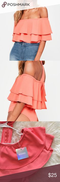 Missguided Bodysuit NWT Missguided choker Bardot off the shoulder bodysuit. Beautiful coral color. US size 6. Brand new with tags! Only sign of wear is a little bit of makeup on the choker, I'm sure it would come out if washed!                                                                                                 •n o  t r a d e s• •s m o k e  f r e e / p e t  f r e e  h o m e•   •s a m e / n e x t  d a y  s h i p p i n g• Missguided Tops