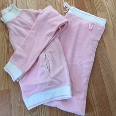 Victoria Secret Sweat Suit Selling on behalf of a friend who purchased this item and then never wore it. When inspecting the item I found two small marks as shown in photo. Outfit is brand new, I don't want to remove the tag to wash/ try to remove  stain. Friend is not sure if she bought the item like that or if it was from being in her closet. Size large. 83% cotton 17% nylon. Sweat pants have one back pocket. Top has two front pockets, no zipper or anything to close them. Victoria's Secret…