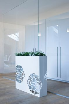 Partition, vase and lamp, several functions combined in a single, highly appealing element with strong visual and theatrical impact. Made in laser-cut..