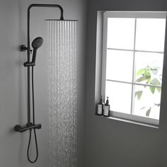 Minimalist yet ingenious, the Gwen Faucet Family features a sleek rainfall shower head and a thermostatic shower valve to bring both great function and everlasting beauty for your bathroom upgrade. Featuring clean sleek lines with ultra-thin shower h Shower Taps, Shower Fixtures, Shower Valve, Bathroom Shower Faucets, Concrete Bathroom, Bathroom Mirrors, Bad Inspiration, Bathroom Inspiration, Bathroom Ideas