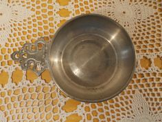Pewter Porringer from Woodbury Pewterers with filigreed handle bowl with 5 inch diameter 1 1/2 inches deep by Daiya on Etsy https://www.etsy.com/listing/200632547/pewter-porringer-from-woodbury-pewterers