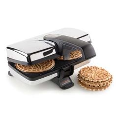 ChefsChoice Iron Pizzelle Maker | At last! An electric pizzelle iron that makes evenly browned pizzelle FAST. Pizzelle aren't just for Christmas; they're a wonderful, fancy-but-easy, go-to cookie all year round. Serve as is; sprinkled with confectioners' sugar; or rolled into cones and filled.  Includes six recipes; and a wooden roller for shaping hot pizzelle into cannoli.   #kitchen #cooking #Baking #gadgets #tools #Appliances