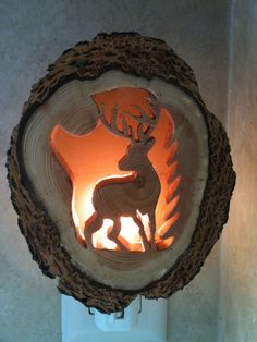 Oh deer! Our big buck night- light is hand-made from Douglas fir, using a scroll saw and an amber colored plastic sheet diffuser. No two night lights are the same, as the natural rings in the wood are