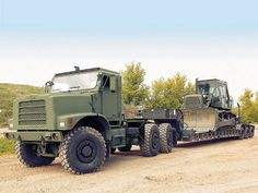 The Medium Equipment Transporter is an integral part of US Marine Corps logistical backbone Big Rig Trucks, Dump Trucks, Oshkosh Military, Offroad, Camo Truck, Rc Tractors, Custom Big Rigs, Army Vehicles, Heavy Truck