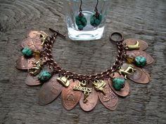 Pressed Penny Bracelet and earrings... Great idea for what to do with those things