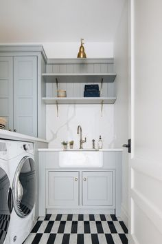 Kate Marker Interiors - Stoffer Photography - Black and white striped marble floor tiles accented a gray laundry room equipped with a white front loading washer and dryer enclosed beneath a white quartz countertop. Grey Laundry Rooms, Laundry Room Design, Laundry Decor, Laundry Closet, Mug Design, Laundry Room Inspiration, Inspiration Design, Design Ideas, Modern Farmhouse Style