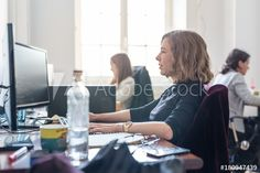Women in startup business and entrepreneurship. Yound devoted female AI programmers and IT software developers team programming on desktop computer in startup company share office space. - Buy this stock photo and explore similar images at Adobe Stock Shared Office, Desktop Computers, Start Up Business, Software Development, Teamwork, Entrepreneurship, Stock Photos, Female, Programming