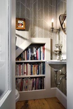Love the bookshelf in the bathroom idea :)