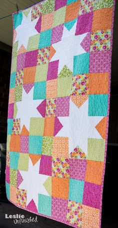 beautiful orange and pinks. Leslie Unfinished quilt