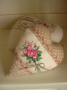 Sweet......any small design would work and then embroider a tiny vine above and below the cross stitch....