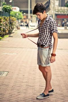 perfect summer look. light denim shorts and plaid button down