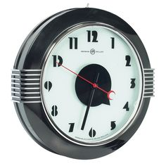 """Large Herman Miller wall clock, Art Deco form with stylized numerals and hands, black enameled case with chrome trim, refinished, signed on face """"Herman Miller Clock Co. Zeeland, Mich. USA"""", 21"""" diameter"""