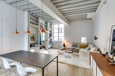 Bright and airy interiors showcased in a Paris bachelor pad