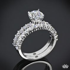 """Beautifully crafted, this """"Diamonds for an Eternity"""" 1/2 Diamond Wedding Set is sure to stand the test of time. The"""