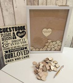 Better than a GUEST book. Have your guests sign a heart and drop it into the frame.