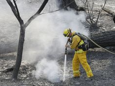 A Sonoma Valley firefighter sprays water on a hot spot from the Rocky Fire near Clearlake, Calif. Thousands of firefighters battling an unruly Northern California wildfire were aided overnight by cooler temperatures and higher humidity, but the fire is still less than a quarter contained.   Jeff Chiu, AP