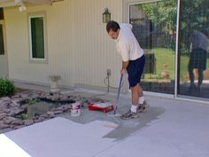 How to stain a concrete patio, step 4...apply concrete stain with brush  and dry 24 hours