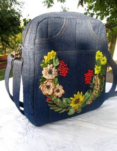 To order. Denim backpack, embroidered backpack, jeans backpack-transformer, recycled jeans shoulder/crossbody bag, ribbon embroidery purse. by IriSribbon on Etsy https://www.etsy.com/listing/561947009/to-order-denim-backpack-embroidered