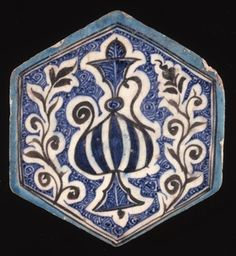 Tile. Ewer and floral sprays. Made of brown, cobalt, turquoise painted pottery.
