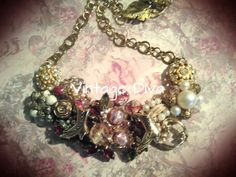 Mixed matched and beoken jewerly from flea markets and yard sales on a B'Aue blank.