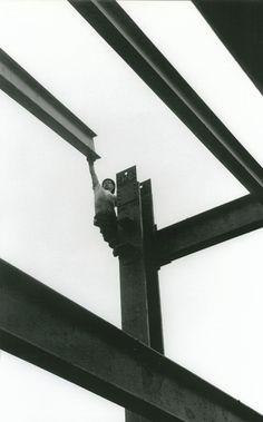 Worker guiding girder by Leonard Ross
