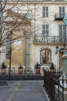 Hôtel Nord-Pinus, Place du Forum, Arles, France. The remains of a Roman monument are visible to the left.