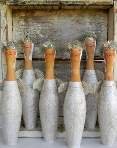Bowling pin angels.  I'd thought of making snowmen out of them, but not angels.  Cool idea.