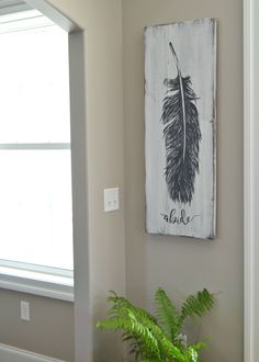 Original ocean-inspired painting on beautiful, rustic, reclaimed barn wood by Aimee Weaver Designs art diy art easy art ideas art painted art projects Wood Feather, Feather Art, Barn Wood Signs, Reclaimed Barn Wood, Rustic Wood, Feather Painting, Painting On Wood, Rustic Painting, Wood Paintings