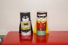 Batman and Robin toilet paper roll toys. I made these for my sons's birthday and came up with the design based on the few wooden peg toys pinned on this board. Robin's pants aren't finished, need another coat and detail. They have felt capes glued on the back too. I meant to change Robin's mouth too so it didn't look so feminine.