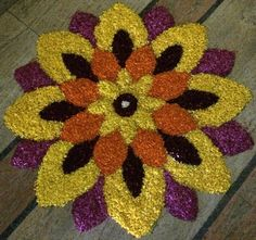 Make these awesome rangoli designs with flowers for Onam, Ugadi, Pongal and Sankranti. Use flower petals to make these pretty rangoli designs with flowers. Easy Rangoli Designs Diwali, Rangoli Designs Flower, Rangoli Border Designs, Rangoli Ideas, Rangoli Designs With Dots, Rangoli Designs Images, Flower Rangoli, Beautiful Rangoli Designs, Simple Rangoli