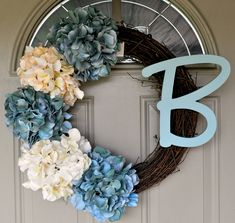 Hydrangea Wreath. I don't like the monogram, but could easily be turned into a fall wreath