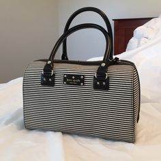 Kate Spade Kaleigh Black & White bag EUC!! No marks or stains. Interior and Exterior are in great condition. Comes with dust bag. Fabric. kate spade Bags Satchels