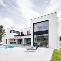 Designed in 2013 by Atelier Form, this modern single family house is situated in Mérignies, France.