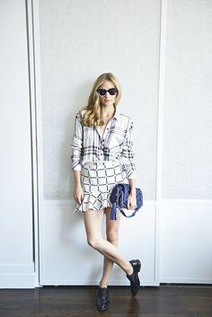 Olivia in Wunderkind sunglasses, a CH Carolina Herrera bag, an ASOS skirt, Celine shoes and Rails top.