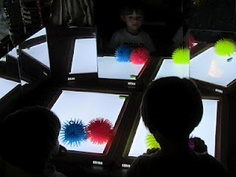 trapping hexbug nano's under the sea urchin balls on the light table