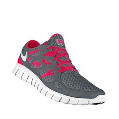 Hot pink and gray Nike tennis shoes