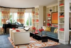 grass cloth wallpaper, the orange and turquis, the mix of neutral, graphic, florals...