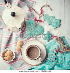 Having coffee at Christmas morning: cup of espresso set with handmade ceramic decorations and italian coffeemaker. Toned photo.