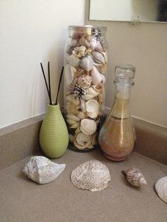 Beach bathroom. Use a tall clear vase to display shells. Check thrift stores for inexpensive and nice vases.