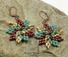 An stunning pair of dangle earrings beaded using Czech SuperDuos. Turquoise picasso, white picasso, and bronze luster opaque red Superduos have been beaded into a swirl star design...very stylish. They hang from antique copper plated leverback earwires.  The earrings measure 2 1/2 long from the top of the earwire to the bottom of the flower. They are 1 1/2 wide. *********************************************************************** All jewelry is packaged ready for gift giving as s...
