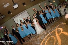 Wedding party poses on dance floor with single letter monogram R after a wild confetti shot. Look at all that confetti. Just wow.  Photo Credit- Kim Greer  #CincinnatiWedding #PartyPleasers #Singlelettermonogram #Confettishot Voice Of America, Letter Monogram, Photo Credit, Confetti, The Voice, Floor, Poses, Dance, Lettering