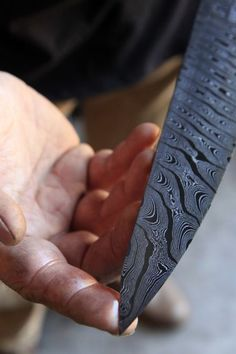 Intricate patterns are created on a blade by twisting the Damascus steel during the forging process.