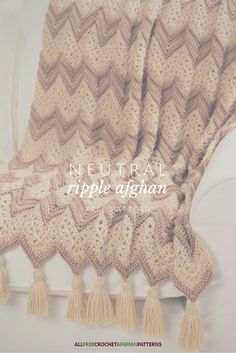 You can't go wrong with a neutral colored crochet afghan. Loving the tassels too.