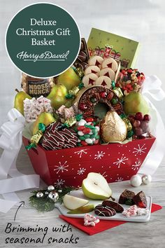 Delight friends, family, and coworkers with a decorative Christmas gift basket filled to the brim wi Food Baskets For Christmas, Food Gift Baskets, Christmas Food Gifts, Christmas Gift Baskets, Family Christmas, Holiday Gifts, Christmas Pictures, Moose Munch, Chocolate Moose