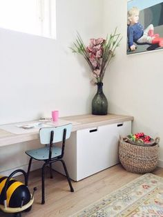 Ikea Stuva children's desk hack with a custom top made from floor panels. Great solution for play and storage. Toy storage basket comes from Zara.