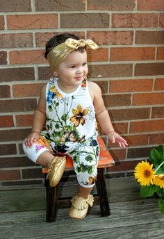 This wildflower romper fuses an assortment of colorful flowers, flourishing a radiant summer warming feeling. This stylish baby girl romper can be easily combined with a bright, golden headband and so