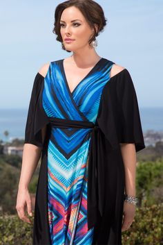 Hair up, our plus size Serene Maxi Dress and a gorgeous backdrop is the perfect combination for a picture-perfect vacation. Browse our entire made in the USA collection  for more travel-ready style at www.kiyonna.com.