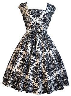 The dress features a full circle 1950s style flared skirt, a fitted bodice & really cute...